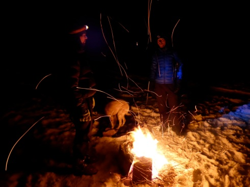 Campfire sparks over the snow.